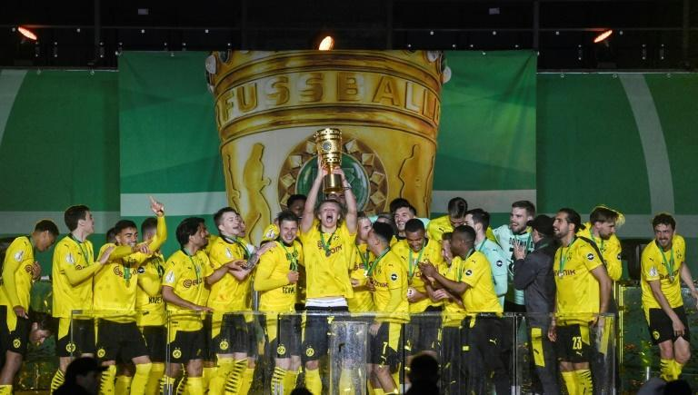 Erling Braut Haaland lifts the trophy after Dortmund won the German Cup final on Thursday