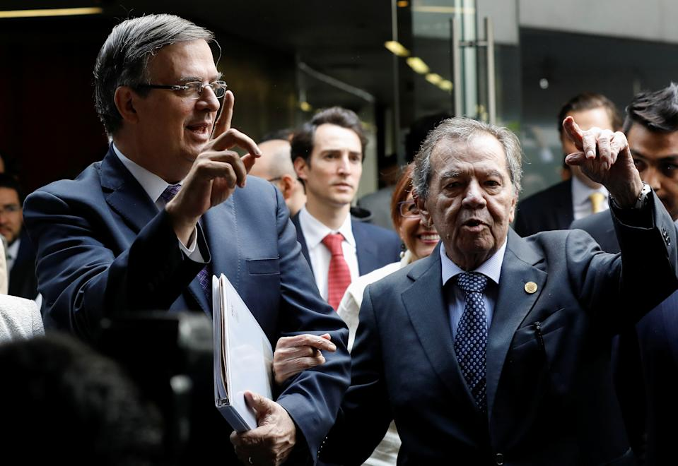 Mexico's Foreign Minister Marcelo Ebrard (L) and lawmaker Porfirio Munoz Ledo of the ruling Morena party gesture while arriving to the Senate building in Mexico City, Mexico June 14, 2019. REUTERS/Carlos Jasso