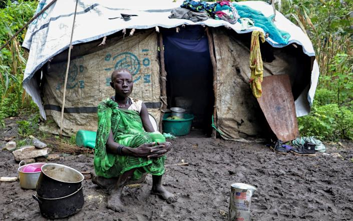 A young Sudanese woman sits in front of her shelter after heavy rainfall and flooding destroyed her crops. Flooding has affected well over a million people across East Africa, another calamity threatening food security on top of a historic locust outbreak and the coronavirus pandemic.  -  Tetiana Gaviuk