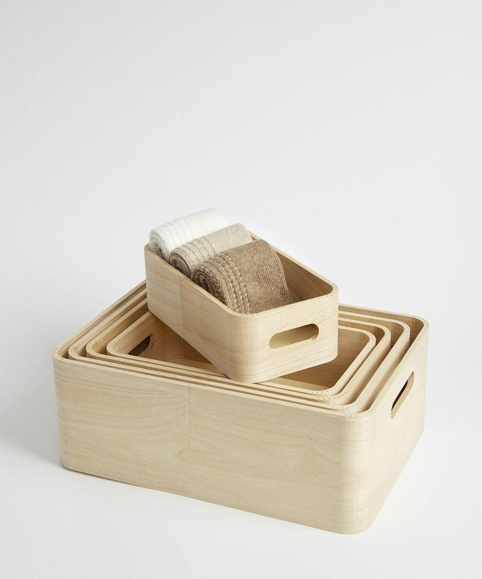 """<h2>KonMari Wooden Stacking Boxes</h2><br>Somehow Marie Kondo made wooden boxes sexy, making them the perfect gift.<br><br><strong>KonMari</strong> Set of Five Wooden Stacking Storage Boxes, $, available at <a href=""""https://go.skimresources.com/?id=30283X879131&url=https%3A%2F%2Fshop.konmari.com%2Fcollections%2Ftidying-organization%2Fproducts%2Fkonmari-tidying-rig-tig-stacking-boxes"""" rel=""""nofollow noopener"""" target=""""_blank"""" data-ylk=""""slk:KonMari"""" class=""""link rapid-noclick-resp"""">KonMari</a>"""