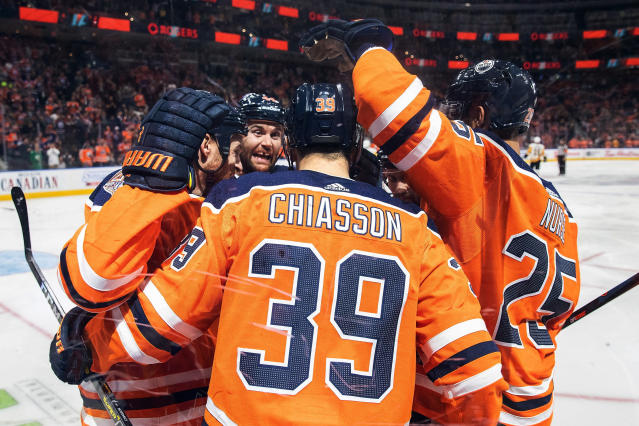 Edmonton Oilers' Kyle Brodziak (28), Alex Chiasson (39), Zack Kassian (44) and Darnell Nurse (25) celebrate Chiasson's goal against the Pittsburgh Penguins during the second period of an NHL hockey game, in Edmonton, Alberta, Tuesday, Oct. 23, 2018. (Codie McLachlan/The Canadian Press via AP)