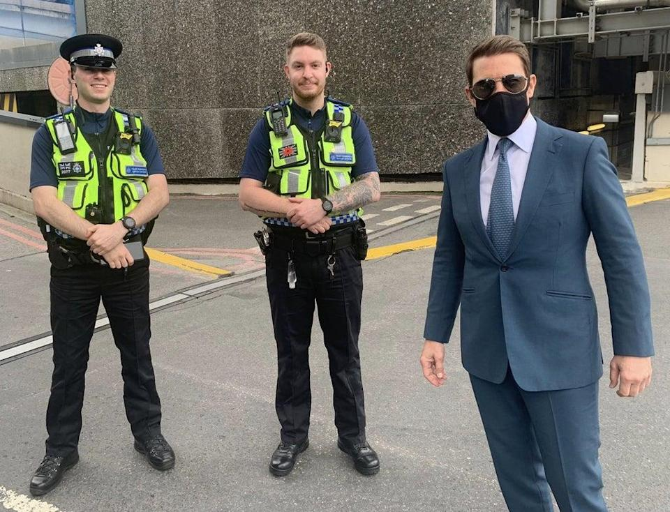 Tom Cruise posing for a photo with BTP officers at Birmingham New Street station (British Transport Police/PA) (PA Media)