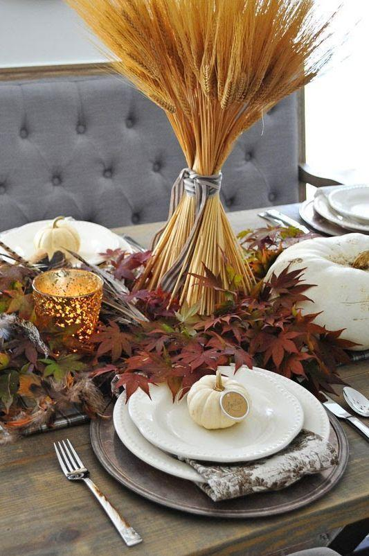 "<p>When it comes to Thanksgiving decor, wheat stalks are a popular choice. Take yours to the next level by setting them on a pile of leaves straight from your yard. Add pumpkins and tea lights for more visual interest.<br></p><p><em><a href=""http://dearlillieblog.blogspot.com/2014/11/a-simple-thanksgiving-table-setting.html"" rel=""nofollow noopener"" target=""_blank"" data-ylk=""slk:Get the tutorial at Dear Lillie »"" class=""link rapid-noclick-resp"">Get the tutorial at Dear Lillie »</a></em></p>"