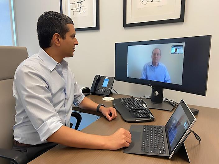 Christopher Ramos, a gastroenterologist with Texas Digestive Disease Consultants, meets with a patient through telehealth July 1.