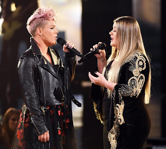 Kelly Clarkson and P!nk onstage during the 2017 American Music Awards at Microsoft Theater on Nov. 19 in Los Angeles. (Getty Images)