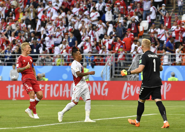 Peru's Christian Cueva, center, reacts after failed to score on a penalty kick during the group C match between Peru and Denmark at the 2018 soccer World Cup in the Mordovia Arena in Saransk, Russia, Saturday, June 16, 2018. (AP Photo/Martin Meissner)