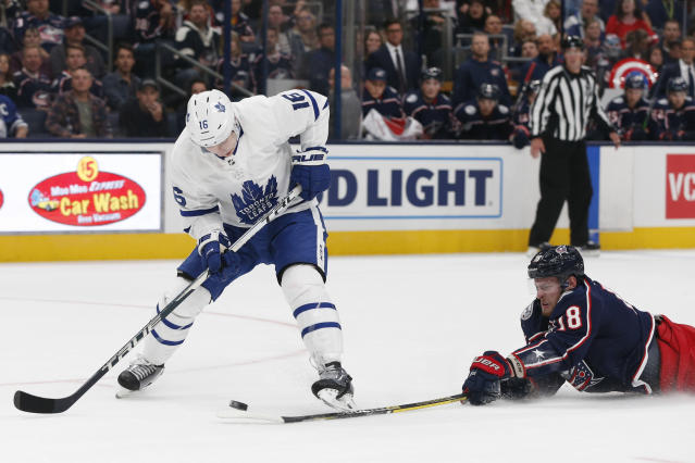 Columbus Blue Jackets' Pierre-Luc Dubois, right, knocks the puck away from Toronto Maple Leafs' Mitchell Marner during the first period of an NHL hockey game Friday, Oct. 4, 2019, in Columbus, Ohio. (AP Photo/Jay LaPrete)