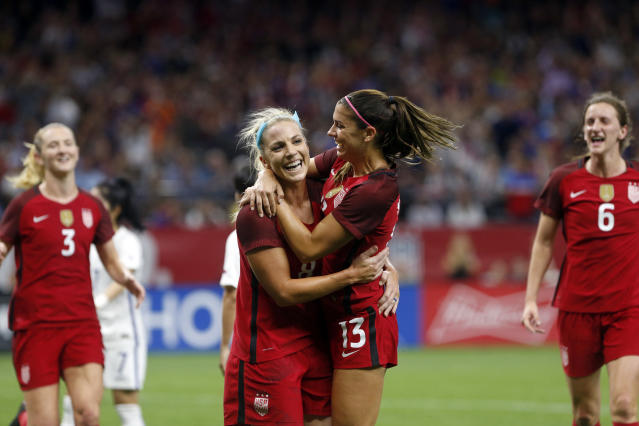 "Julie Ertz, <a class=""link rapid-noclick-resp"" href=""/olympics/rio-2016/a/1124331/"" data-ylk=""slk:Alex Morgan"">Alex Morgan</a> and the USWNT beat South Korea, but turf issues remain for their games. (AP)"
