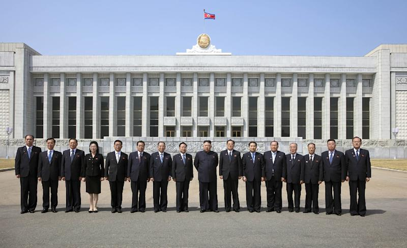 North Korean leader Kim Jong Un poses with members of the newly-formed Presidium of the Supreme People's Assembly at Mansudae Assembly Hall in Pyongyang
