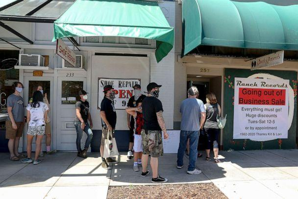 PHOTO: People line up to enter Ranch Records for the going out of business sale in Salem, Ore., June 23, 2020. The record store is closing after nearly 40 years in business. (Brian Hayes/Statesman Journal via USA Today Network)