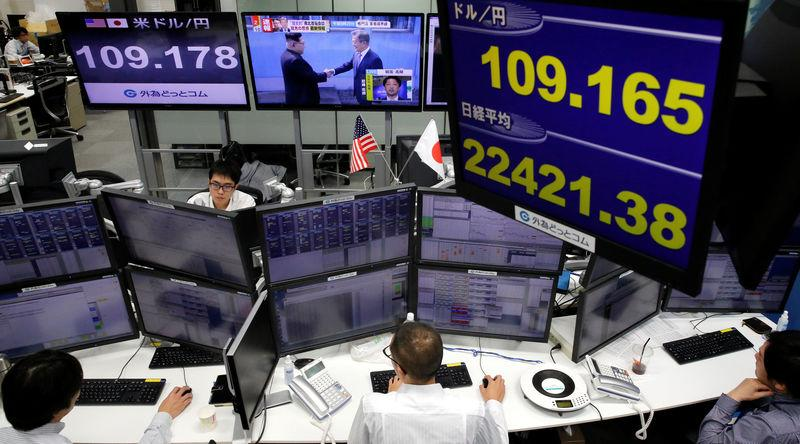 Monitors showing TV program on the inter-Korean summit (C top), the Japanese yen's exchange rate against the U.S. dollar (top L and top of blue screen) and Japan's Nikkei share average (bottom of blue screen) are seen at a foreign exchange trading company in Tokyo, Japan, April 27, 2018. REUTERS/Toru Hanai