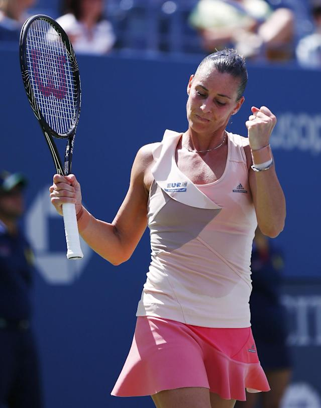 Flavia Pennetta, of Italy, reacts after defeating Nicole Gibbs, of the United States, during the third round of the 2014 U.S. Open tennis tournament, Saturday, Aug. 30, 2014, in New York. (AP Photo/Matt Rourke)