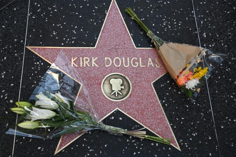 Flowers were placed on Kirk Douglas's star on the Hollywood Walk of Fame after news of his death spread