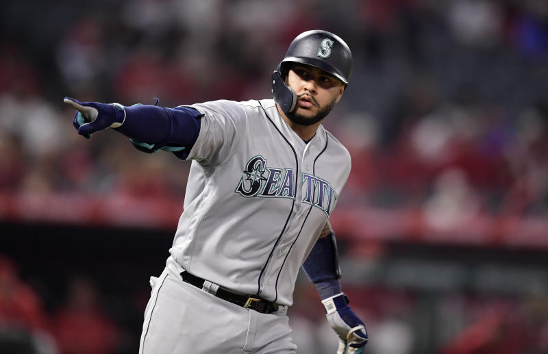 Seattle Mariners' Omar Narvaez points to his dugout as he round first after hitting a solo home run during the ninth inning of the team's baseball game against the Los Angeles Angels on Friday, April 19, 2019, in Anaheim, Calif. (AP Photo/Mark J. Terrill)