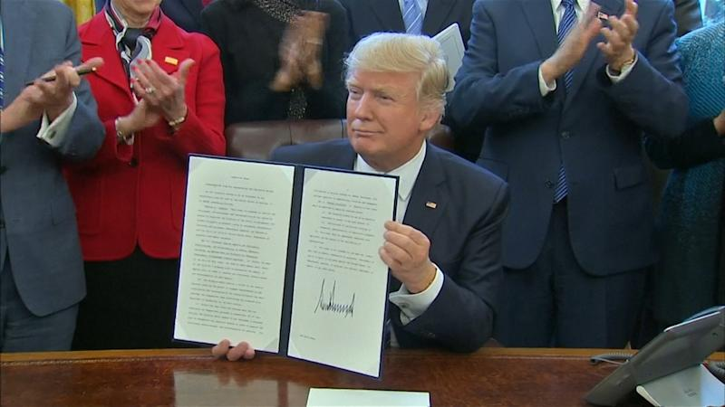 """U.S. President DonaldTrumpsigns a """"long overdue"""" reorganization of federal departments and agencies aimed at saving money and eliminating duplication."""
