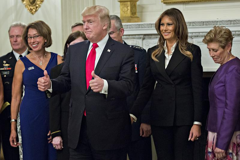 President Donald Trump and first lady Melania Trump were hosting a dinner with senior military leaders Thursday night. (Bloomberg via Getty Images)