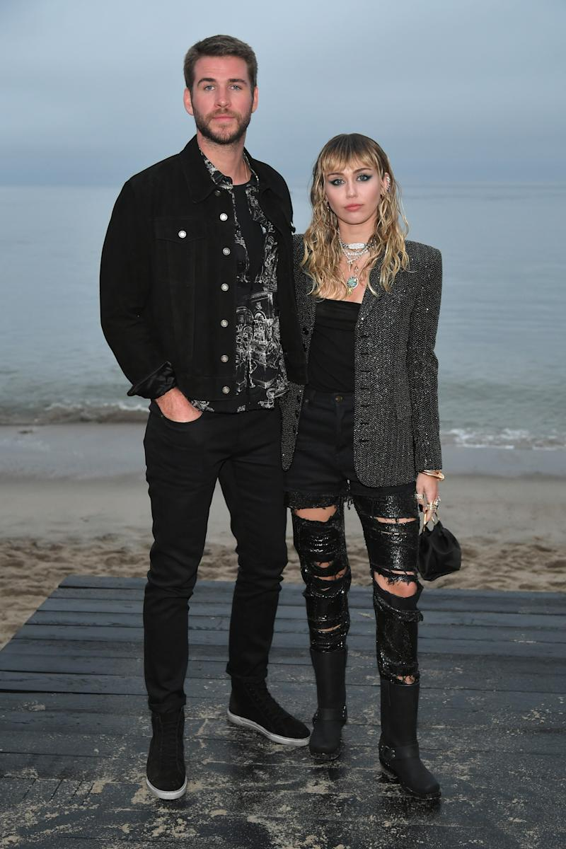 Liam Hemsworth and Miley Cyrus attend the Saint Laurent Mens Spring Summer 20 Show Photo Call on June 06, 2019 in Malibu, California.