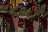 Indian police officers pay respect to their colleague Rameez Ahmad during a wreath laying ceremony in Srinagar, Indian controlled Kashmir, Thursday, April 1, 2021. Gunmen in disputed Kashmir on Thursday killed a policeman as they tried to storm the residence of a politician of India's ruling party, police said. (AP Photo/ Dar Yasin)