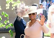 <p>A surprise guest at Prince Harry and Meghan Markle's wedding, Oprah had a striking topper.</p>