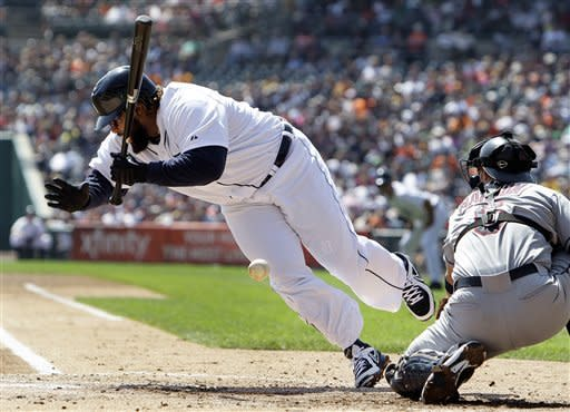 Detroit Tigers' Prince Fielder is hit by a Cleveland Indians starting pitcher Corey Kluber pitch as Lou Marson catches in the first inning of a baseball game in Detroit, Monday, Sept. 3, 2012. (AP Photo/Paul Sancya)
