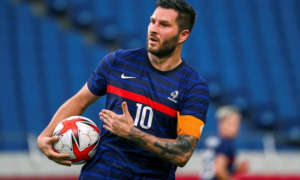 Andre-Pierre Gignac, one of France's over-age players, celebrates a goal in Japan.