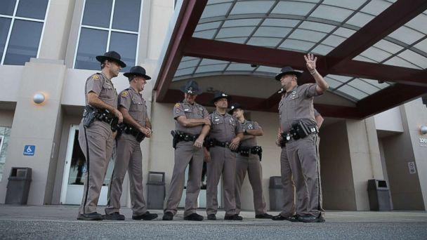 PHOTO: Florida Highway Patrol officers stand outside the Curtis M. Phillips Center for the Performing Arts as they prepare the venue for Thursday's scheduled speech by white nationalist Richard Spencer on Oct. 18, 2017 in Gainesville, Fla. (Joe Raedle/Getty Images/Getty Images)