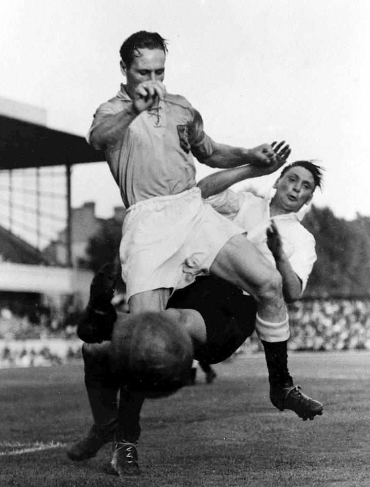 A tackle by centre half Eric Lee of Great Britain, right, on centre forward Appel of Holland, during the Olympic Games Football competition at Highbury Stadium London, July 31, 1948. Great Britain won the match 4-3 after extra time. (AP Photo)