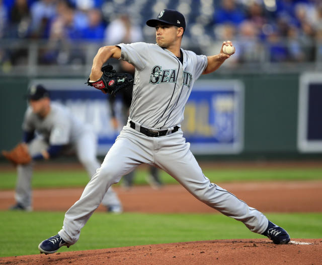 Seattle Mariners starting pitcher Marco Gonzales delivers to a Kansas City Royals batter during the first inning of a baseball game at Kauffman Stadium in Kansas City, Mo., Tuesday, April 9, 2019. (AP Photo/Orlin Wagner)