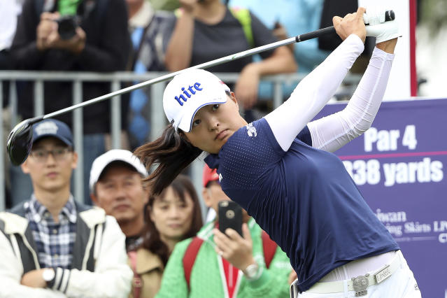 FILE - In this Oct. 31, 2019, file photo, Jin Young Ko of South Korea watches her tee shot on the first hole during the first round of the Taiwan Swinging Skirts LPGA tournament at the Miramar Golf Country Club in New Taipei City, Taiwan. Ko figures to be plenty rested whenever the LPGA Tour resumes. Ko left the CME Group Tour Championship in Naples, Florida, on Nov. 24 as the No. 1 player in women's golf, capping off her four-win, two-major season as the LPGA player of the year and winner of the Vare Trophy for lowest scoring average. The plan was to return for the Asia swing in mid-February and work her way into the season. She's still waiting. (AP Photo/Chiang Ying-ying, File)