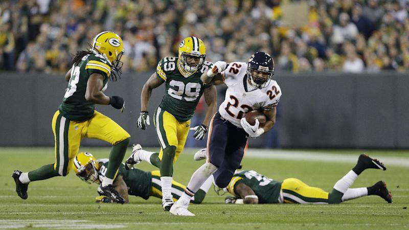 Green Bay Packers' Jerron McMillian (22) breaks away during the first half of an NFL football game against the Green Bay Packers Monday, Nov. 4, 2013, in Green Bay, Wis. (AP Photo/Mike Roemer)