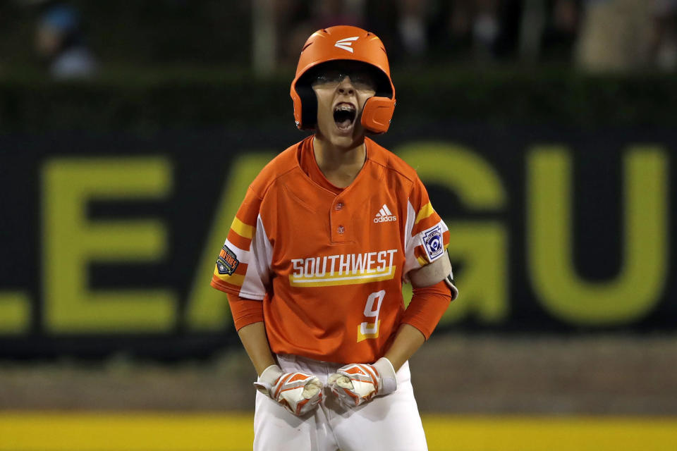 FILE - River Ridge, Louisiana's Conner Perrot celebrates as he stands on second base after driving in two runs with a double off Coon Rapids, Minnesota's Carson Trim in the fourth inning of an elimination baseball game at the Little League World Series tournament in South Williamsport, Pa., in this Monday, Aug. 19, 2019, file photo. The Little League World Series is planning to return in 2021 after last year's edition was canceled due to the COVID-19. (AP Photo/Gene J. Puskar, File)