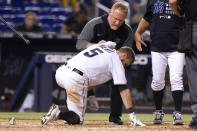 Miami Marlins' Jon Berti (5) has ice applied to his back after being hit by a pitch thrown by San Diego Padres reliever Austin Adams during the seventh inning of a baseball game, Thursday, July 22, 2021, in Miami. (AP Photo/Lynne Sladky)