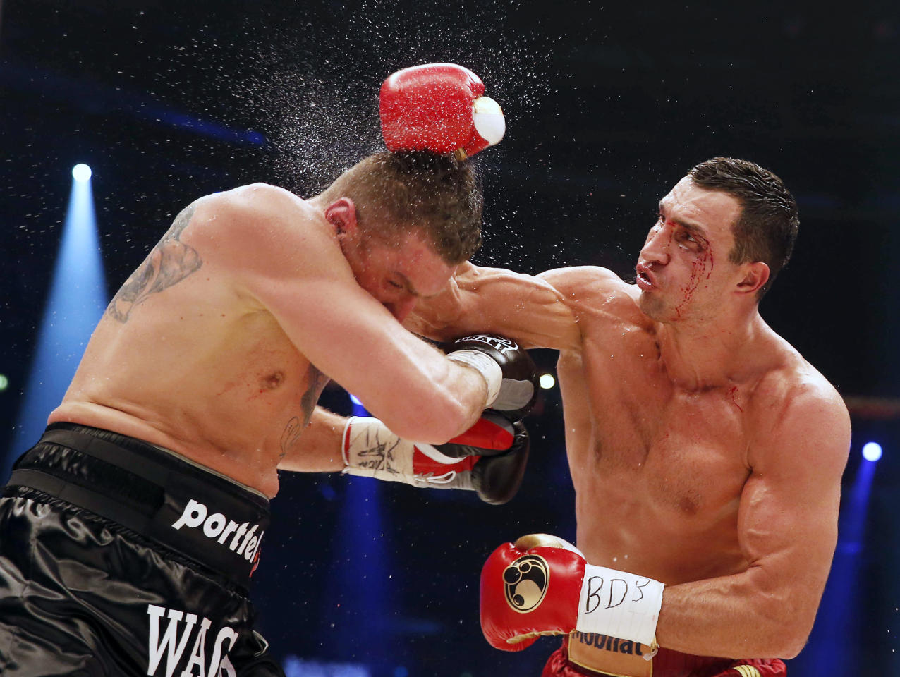 Ukrainian WBA, WBO, IBO and IBF heavy weight boxing world champion Vladimir Klitschko lands a blow on Polish challenger Mariusz Wach during their title bout in Hamburg November 10, 2012.  REUTERS/Morris Mac Matzen (GERMANY - Tags: SPORT BOXING)