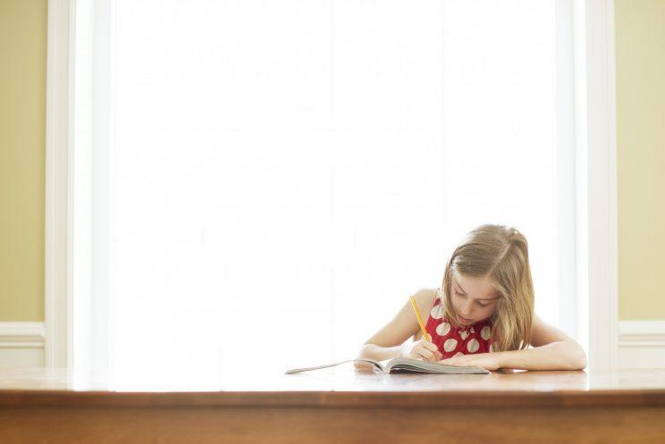 Is homework helping children's learning or an unnecessary burden on parents? [Photo: Getty]