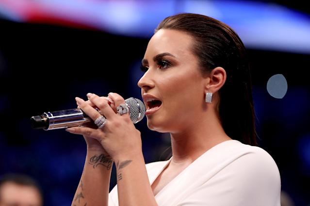 LAS VEGAS, NV - AUGUST 26: Singer Demi Lovato performs the national anthem prior to the super welterweight boxing match between Floyd Mayweather Jr. and Conor McGregor on August 26, 2017 at T-Mobile Arena in Las Vegas, Nevada. (Photo by Christian Petersen/Getty Images)