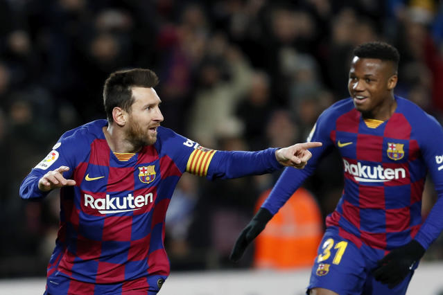 Barcelona's Lionel Messi, left, celebrates with Ansu Fati after scoring the opening goal during a Spanish La Liga soccer match between Barcelona and Granada at Camp Nou stadium in Barcelona, Spain, Sunday, Jan. 19, 2020. (AP Photo/Joan Monfort)