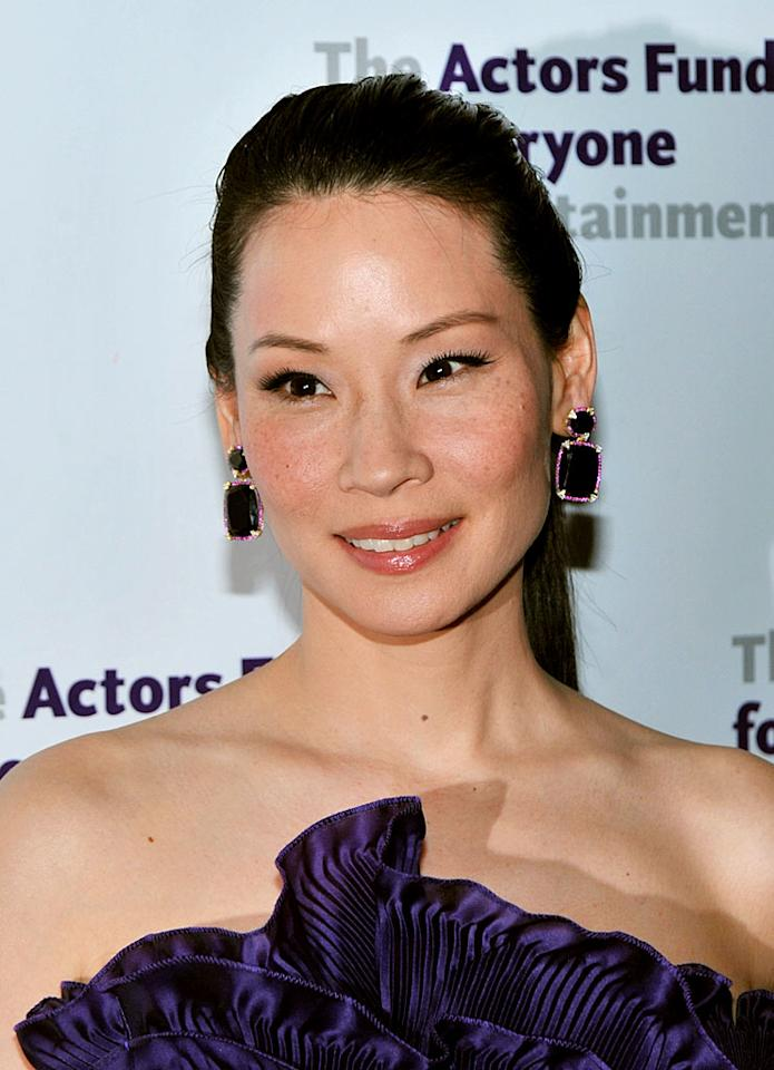 """When you have great skin like """"Charlie's Angels"""" star Lucy Liu, you don't have to pile on the makeup. The 41-year-old allowed her freckles to shine while on the red carpet at a gala in NYC. Henry S. Dziekan III/ WireImage.com - April 12, 2010"""