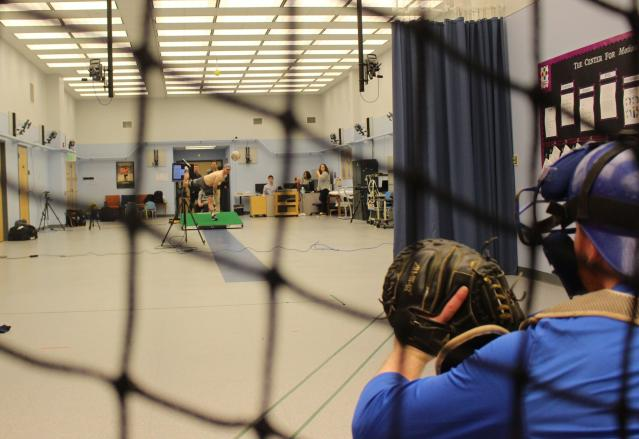 Central Connecticut pitcher Michael DeLease throws off a smart mound at the Center for Motion Analysis in Farmington, Conn. on Tuesday, Jan. 28, 2020. The new technology allows scientists to better study pitching mechanics to enhance efficiency and prevent injuries. (AP Photo/Pat Eaton-Robb)