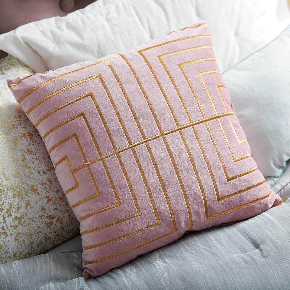 """A soft-pink fabric accented with golden-thread piping captures the dichotomy of effortless luxury.<br><br><strong>MoDRN Glam</strong> Metallic Stitched Decorative Throw Pillow, $, available at <a href=""""https://go.skimresources.com/?id=30283X879131&url=https%3A%2F%2Fwww.walmart.com%2Fip%2FMoDRN-Glam-Metallic-Stitched-Decorative-Throw-Pillow-20-x-20%2F322050800"""" rel=""""nofollow noopener"""" target=""""_blank"""" data-ylk=""""slk:Walmart"""" class=""""link rapid-noclick-resp"""">Walmart</a>"""