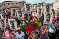 Supporters of Nicolas Ernesto Maduro Guerra, son of the Venezuelan president and candidate in the upcoming legislative elections, are seen at a campaign rally in La Guaira