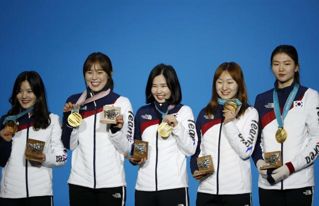 Medals Ceremony - Short Track Speed Skating Events - Pyeongchang 2018 Winter Olympics - Women's 3000 m - Medals Plaza - Pyeongchang, South Korea - February 21, 2018 - Gold medalists Shim Sukhee, Minjeong Choi, Kim Alang and Kim Yejin of South Korea on the podium. REUTERS/Kim Hong-Ji