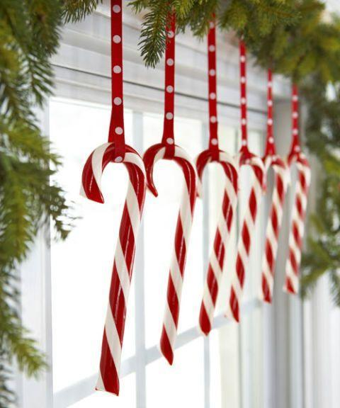 "<p>Keep treats on display (and out of kids' and pets' reach) by hanging them along the top of a window. Hooked on matching ribbon, the peppermints look extra sweet. </p><p>See more at <a href=""http://www.goodhousekeeping.com/holidays/christmas-ideas/how-to/g2203/christmas-decoration-ideas/"" rel=""nofollow noopener"" target=""_blank"" data-ylk=""slk:Good Housekeeping"" class=""link rapid-noclick-resp"">Good Housekeeping</a>. </p>"