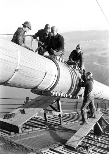 Workers on the main cable of the Golden Gate Bridge. From the holdings of the Golden Gate Bridge, Highway and Transportation District, Used with Permission, www.goldengate.org