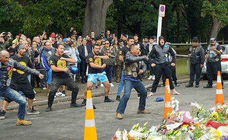FILE PHOTO: Members of a New Zealand biker gang perform the Haka to honour the victims of the mosque shootings in Christchurch, New Zealand, March 17, 2019. REUTERS/Joseph Campbell/File Photo
