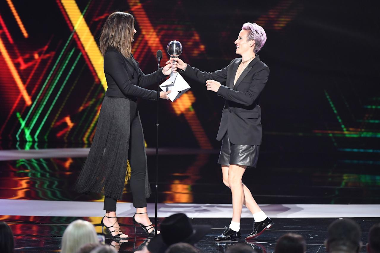 Megan Rapinoe wore a tuxedo blazer with leather shorts from Coach.