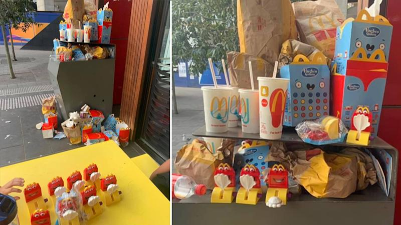 McDonald's Happy Meal toys and packaging piled up in rubbish bins in Sydney's Darling Harbour.