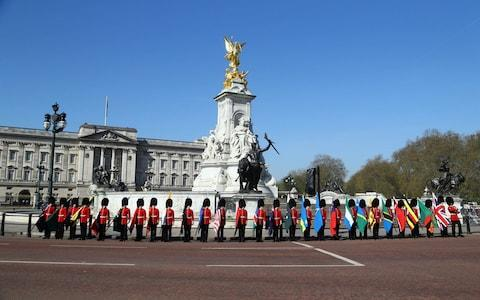 Soldiers of the Coldstream Guards carry flags of the 53 Commonwealth countries at Buckingham Palace - Credit: Gareth Fuller/PA