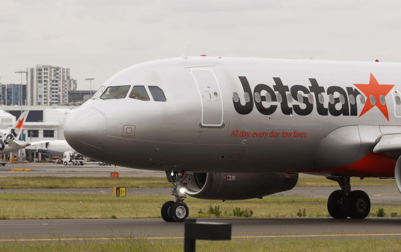 A Jetstar plane prepares to take off at Kingsford Smith International Airport in Sydney.