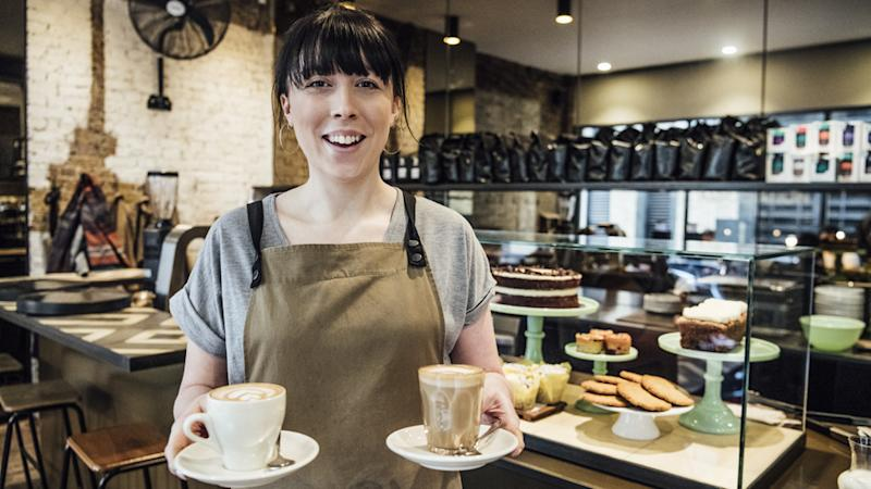 A waitress carrying coffee