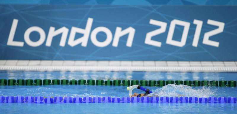 A swimmer practices in the pool during a training session at the Aquatics Center at the Olympic Park ahead of the 2012 Summer Olympics, Tuesday, July 24, 2012, in London. Opening ceremonies for the 2012 London Olympics will be held Friday, July 27. (AP Photo/Matt Slocum)